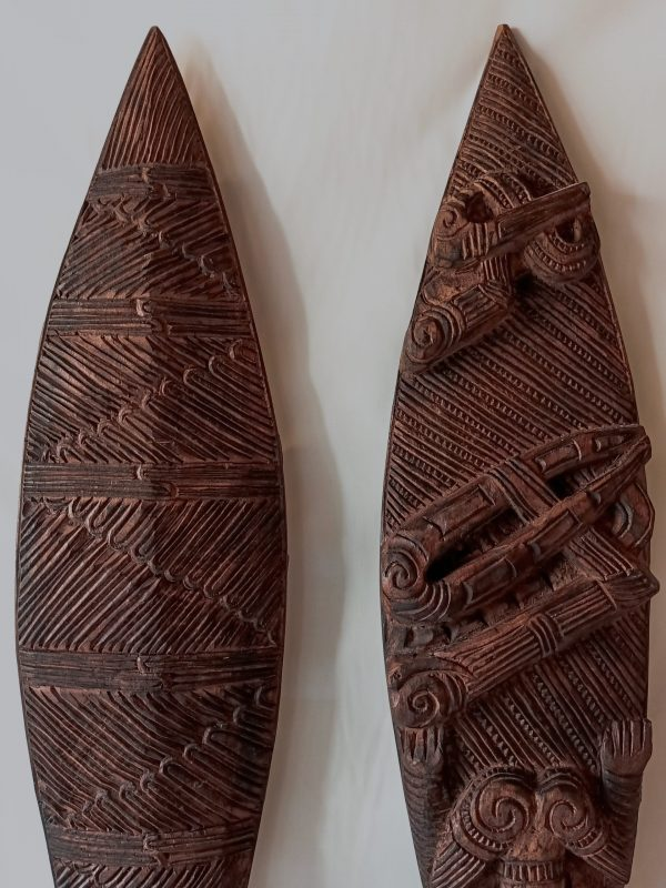 ethnic carved wood paddle