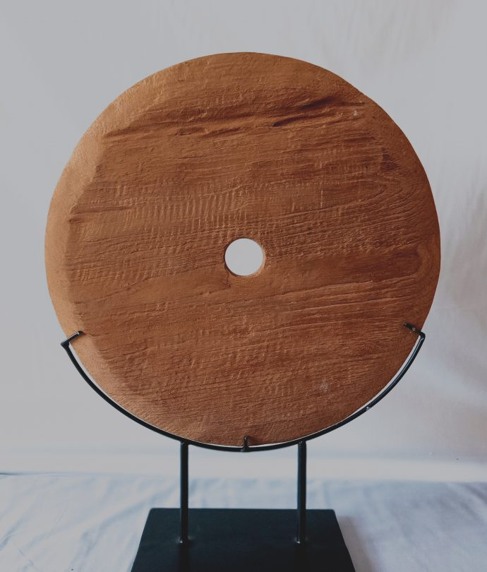 wooden disc on stand